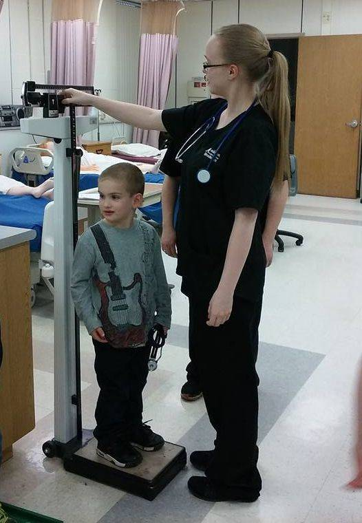 Student Measuring Patient Height