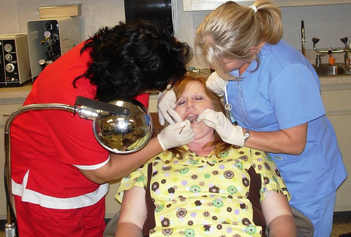 Dental Students Examines Patient