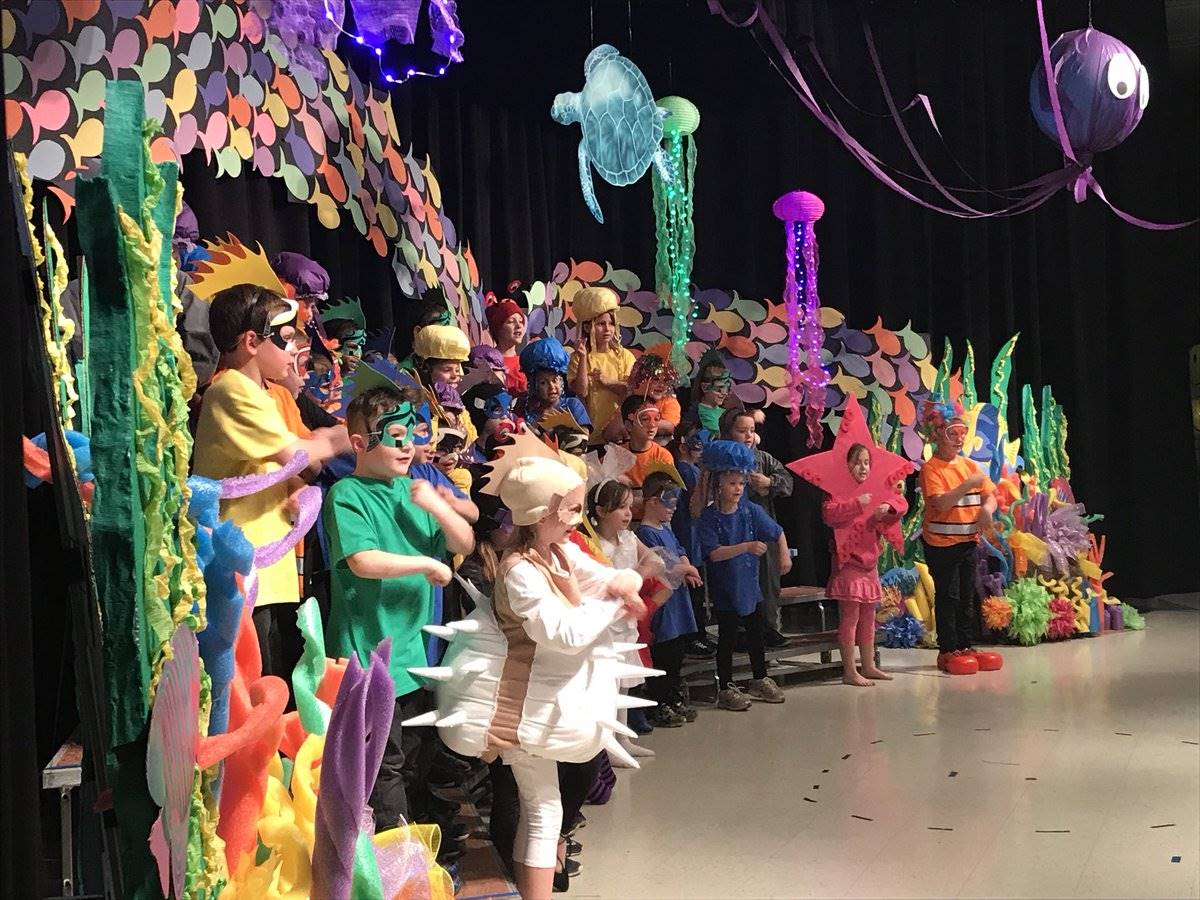 First graders sing on stage
