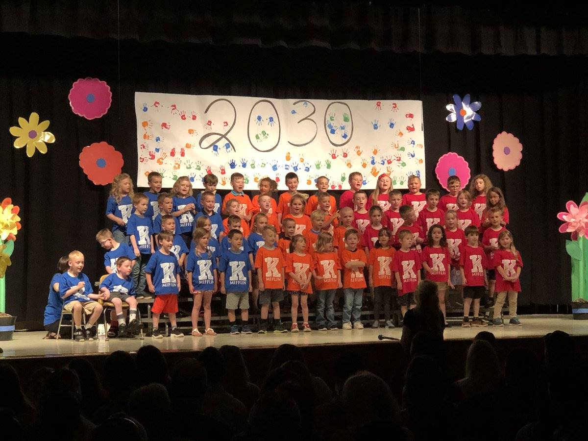 Kindergarten students lined up for graduation on stage