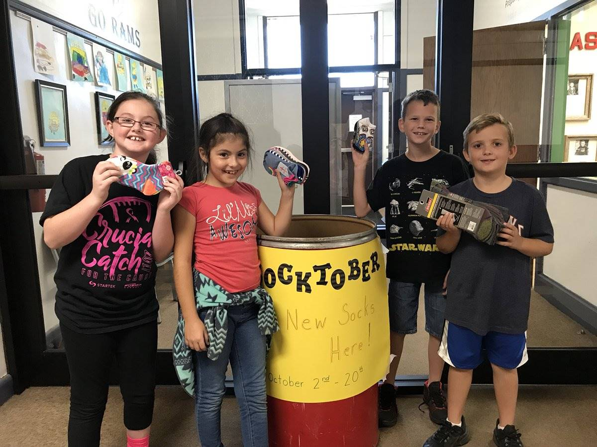 Students collecting donated socks