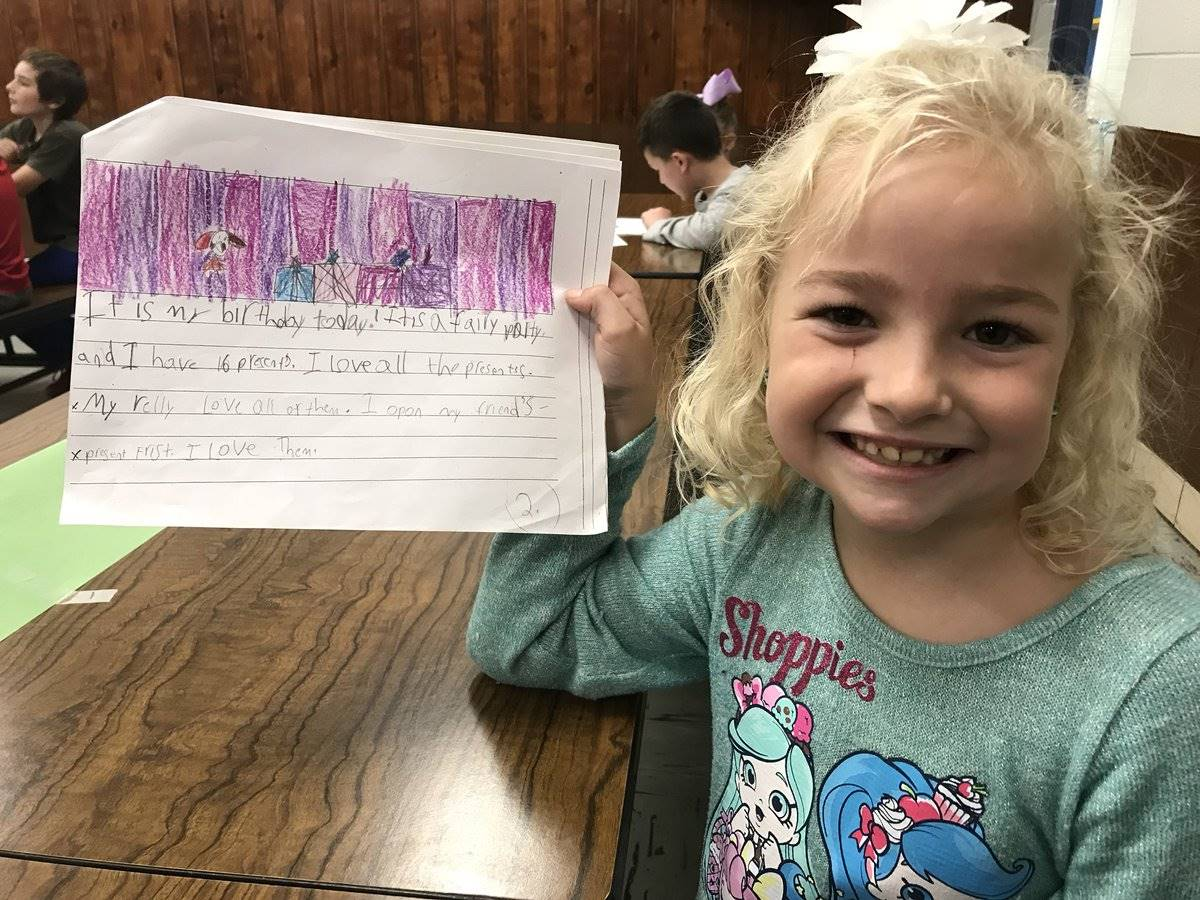 Student showing off her writing
