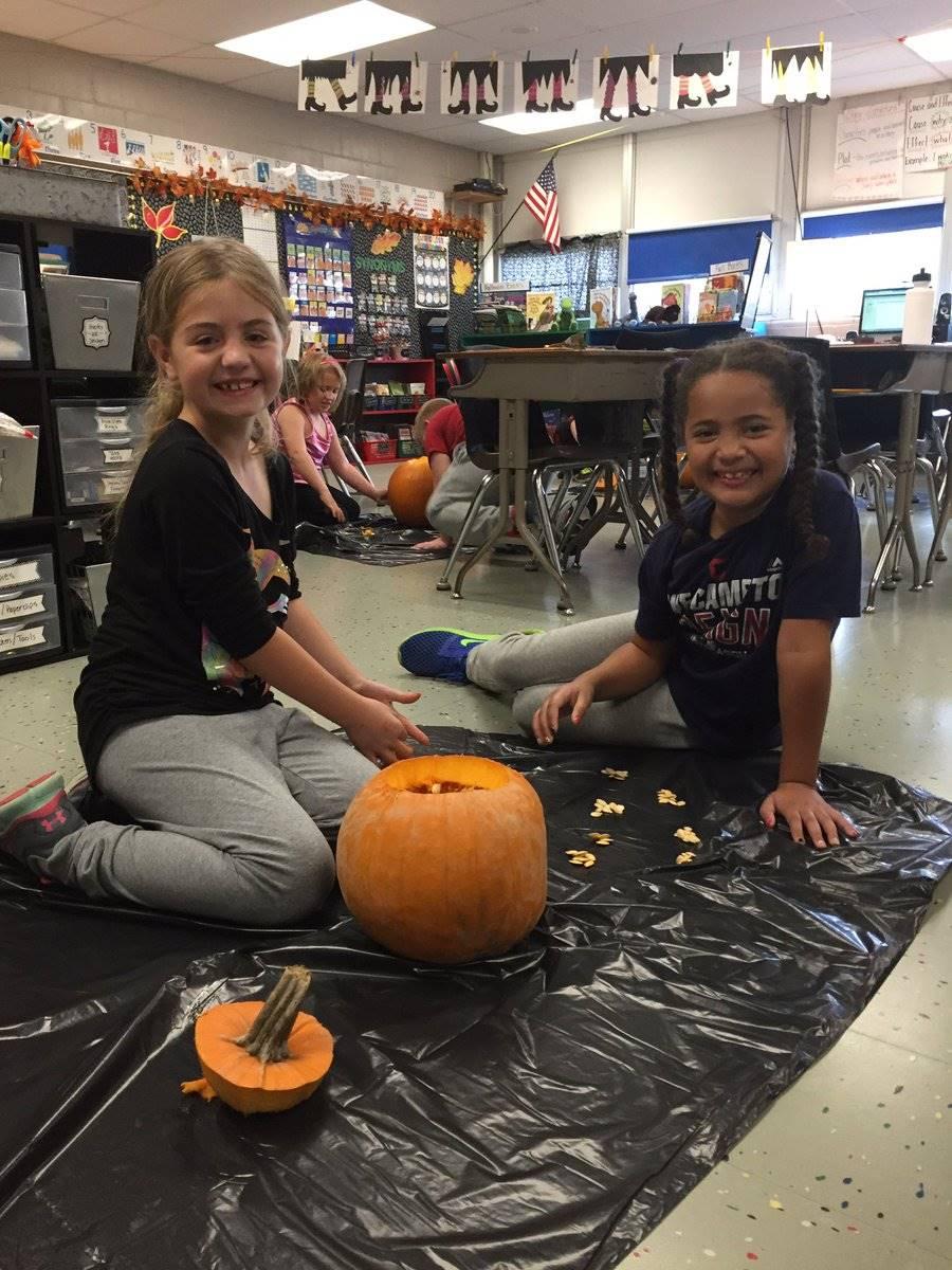 Students decorating a pumpkin