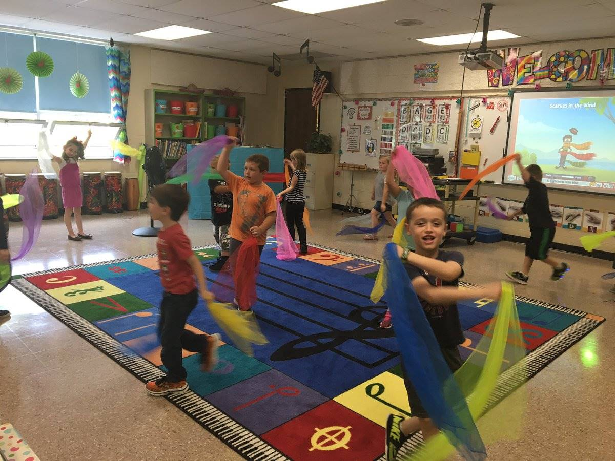 Students dancing with scraves in music