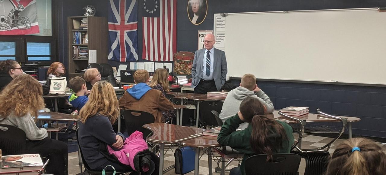 Superintendent John Thomas speaks to History Club