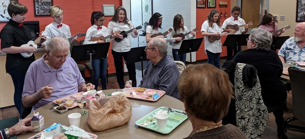 Ukulele club performing at senior citizen lunch