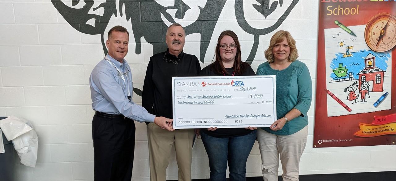 Teacher receiving a grant