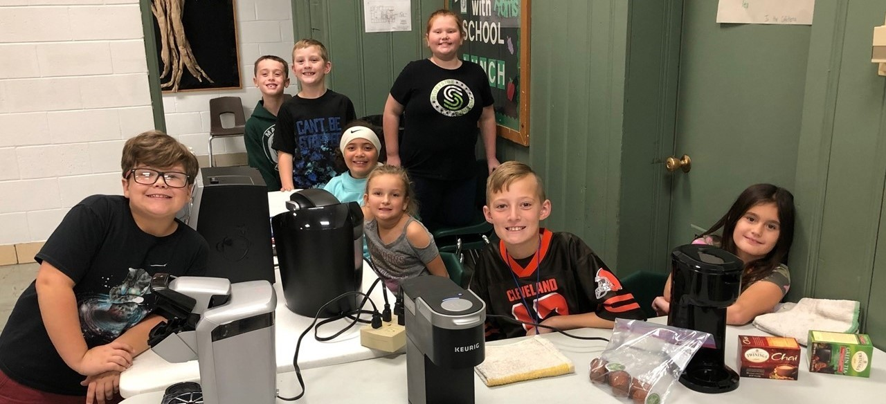 Student lighthouse team sells coffee and other drinks during conferences
