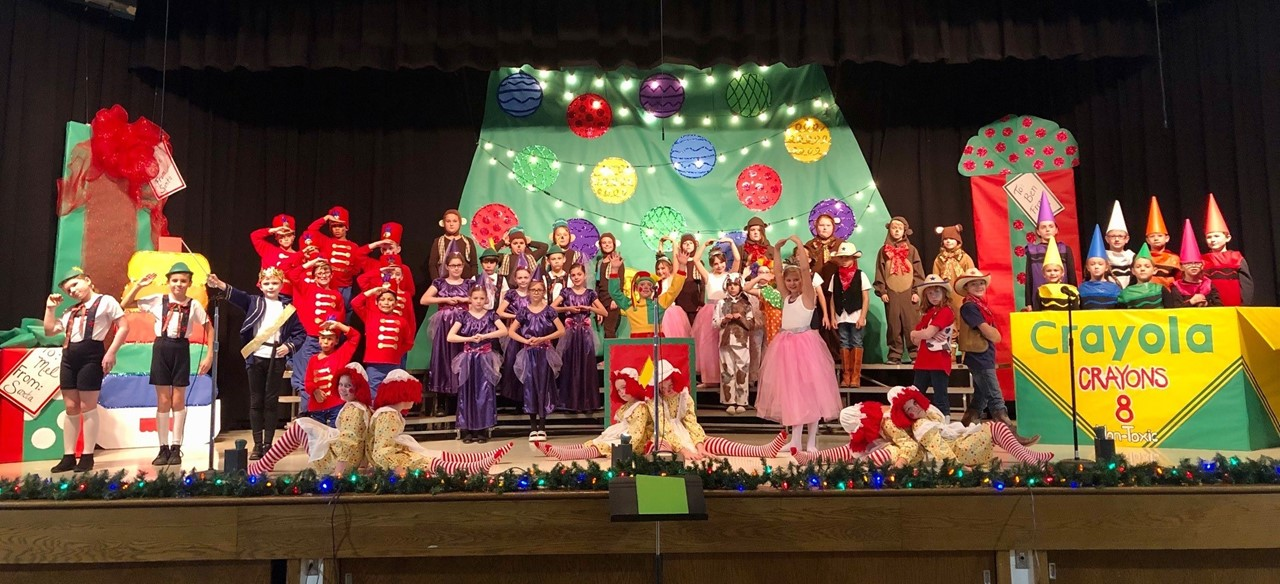 Students dressed as toys for the winter music program