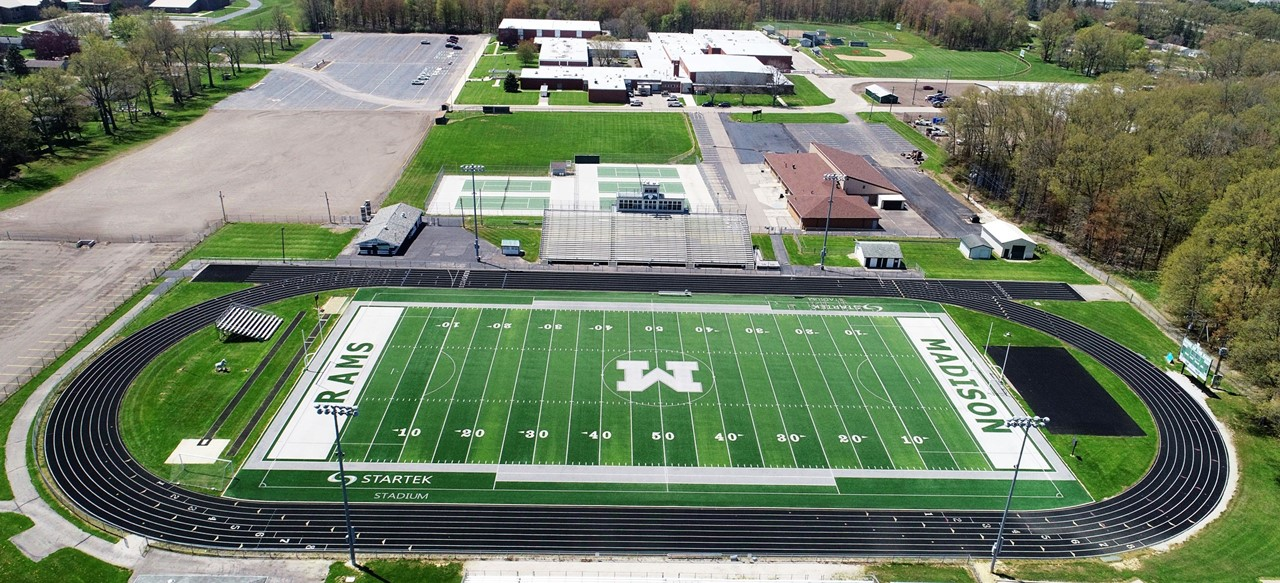 Drone view of Football field and high school