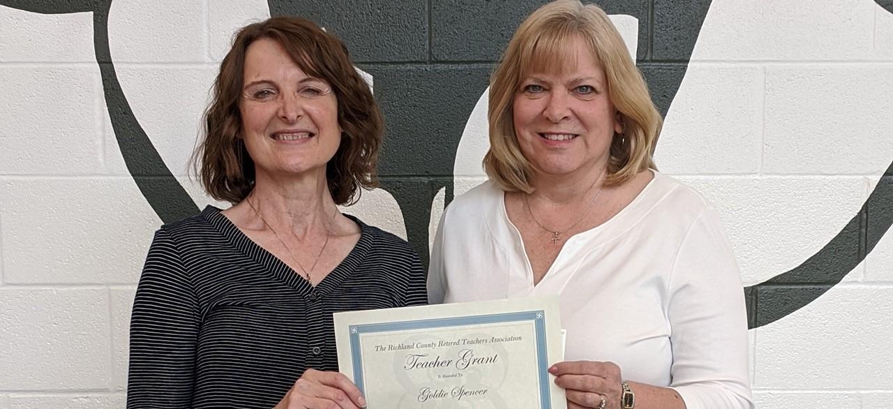 Teacher receiving grant